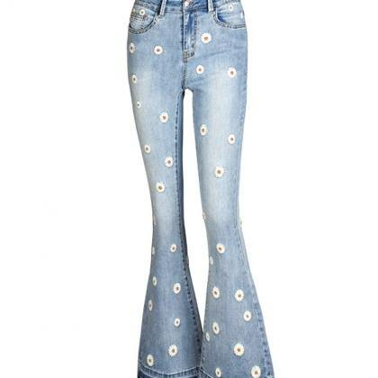 Fashionable flared jeans daisy embr..