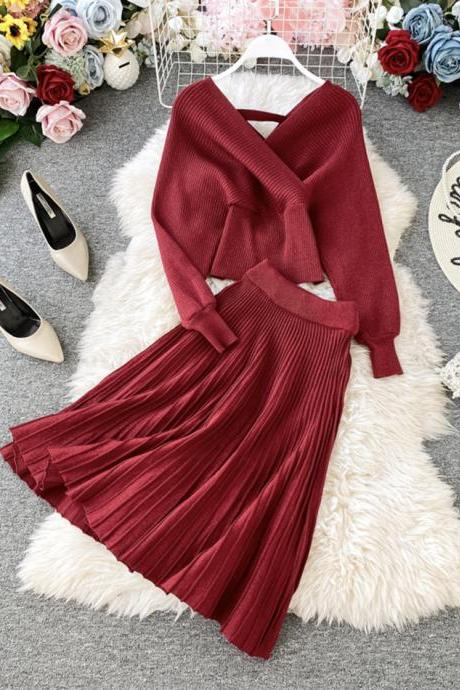 Fashionable sweater suit v-neck bat sleeve bright silk knitted sweater + high waist bag hip skirt two-piece suit